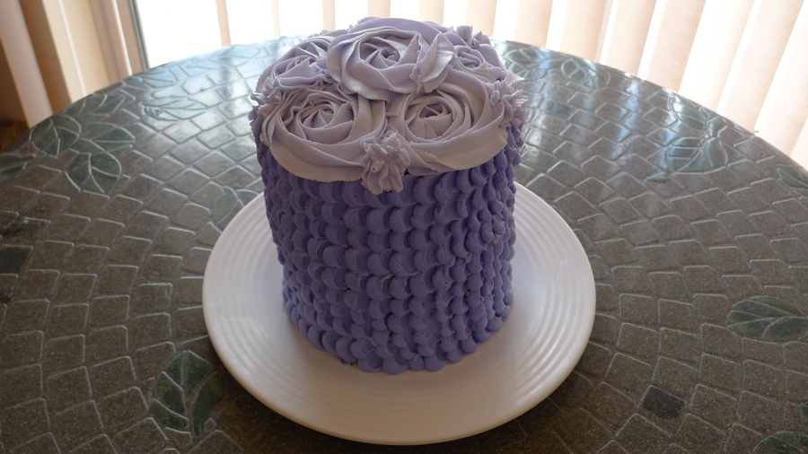 Two tone purple buttercream, 5 layers.  Happens to be gluten free but could be gluten full!