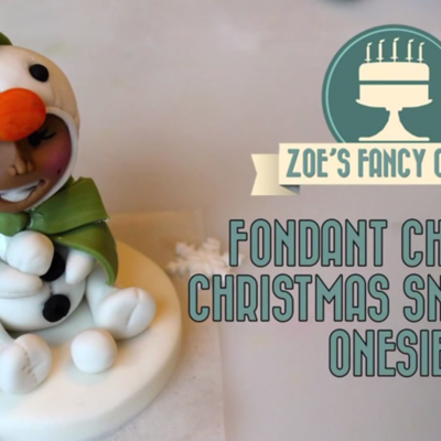 Child in Snowman Onesie on Cake Central