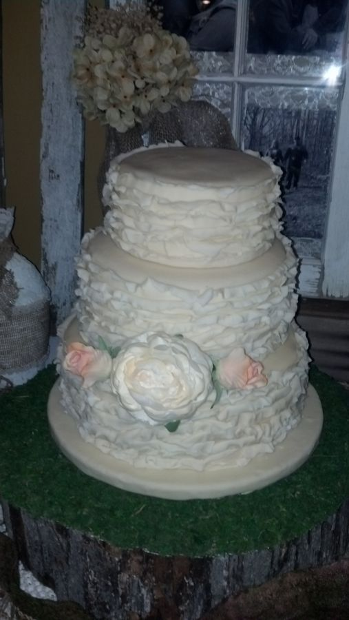 Wedding cake I did for my cousin's niece. The topper isn't on yet.