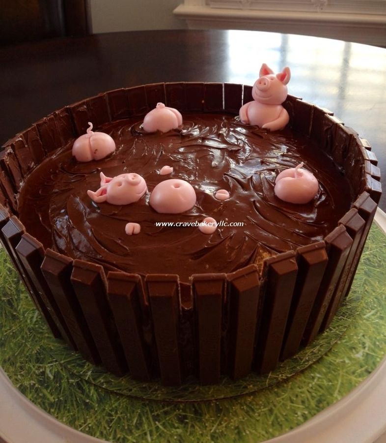 """There are many variations of this cake out there.   Here is Crave's.  :)  There are two 8"""" layers of vanilla, with a layer of nutella on top. The pigs are fondant."""