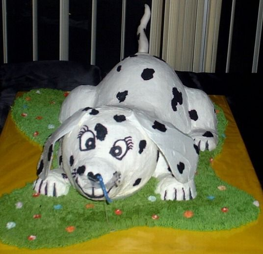 "Could this be the next ""1st dog""? :)    It's all edible down to the dragonfly he is nose to nose to:) -  iced in buttercream.  I used 2 Wonder mold (doll skirt pan) cakes (head & rump) and a mini, cut in 1/2 (rear haunches)."