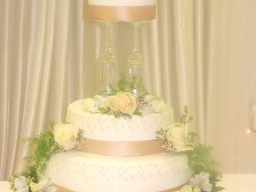 Wedding Cake Held Up By Champagne Flutes - CakeCentral.com