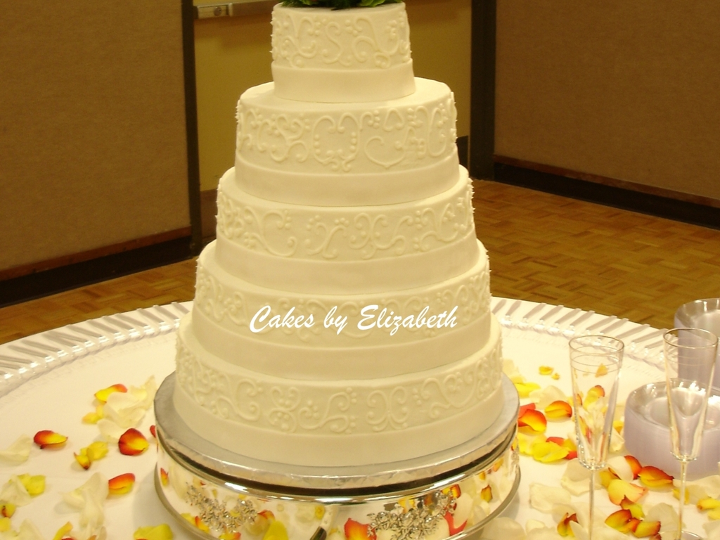 Wedding Cake With Scrolls And Fondant Ribbon - CakeCentral.com