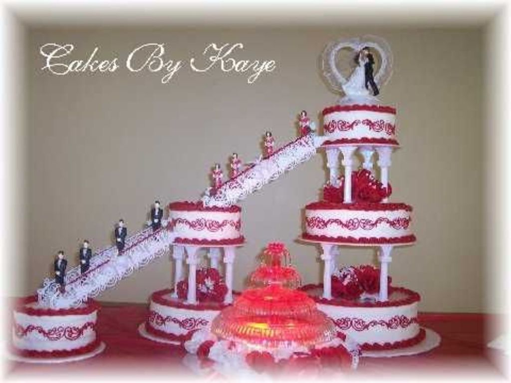 6 Tier Wedding Cake With Fountain Stairs Red White Roses With