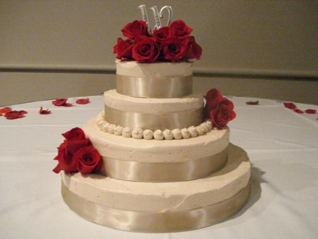 Ivory Wedding Cake With Fresh Red Roses - CakeCentral.com