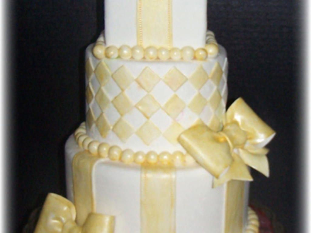 Golden Beads And Bows - CakeCentral.com