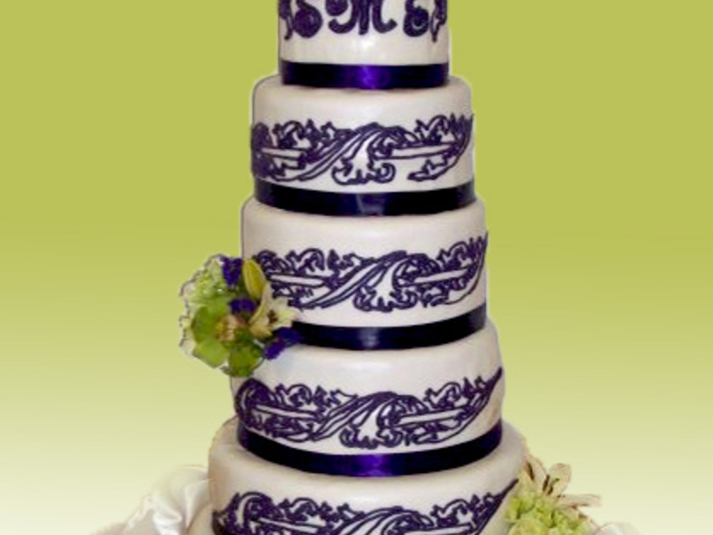 White Fondant Cake With Dark Purple Piping And Green Flowers ...