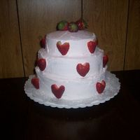 "3-Tier Strawberry Sweetheart Cake I made this cake with 3 layers (10"", 8"" and 6"")of strawberry cake covered in pink whipped creme icing flavored with..."