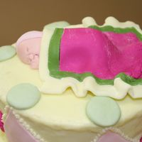 Topsy Turvy Baby Shower This is the baby close-up. This is the cake I wrote about yesterdaythat was cracking. Thanks to my genius friend, loree01, it was saved.She...