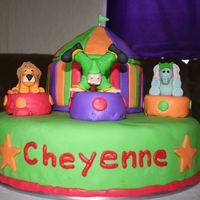 Img_0052.jpg circus cake for 6 year old. Bottom is white single layer cake sitting on top of the cake pan I baked it in, tent is chocolate, figures are...