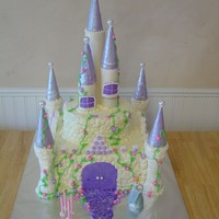 "Castle Cake  Castle cake for a 4 year old. 12"" square and 8"" round. Corner turrets are icecream cones covered with MMF. Used paper towel rolls..."