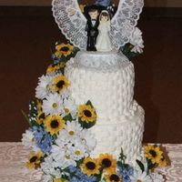 Weddingcakesized2.jpg This is a basket weeve cake I made for my grandsons wedding. I used the almond sourcream cake and wiltons white buttercream frosting and...