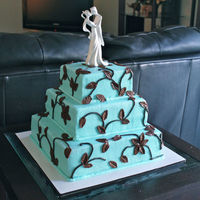 Romance Cake Smooth frosted buttercream in Teal/Tiffany blue. Chocolate brown fondant leaves.Cake was vanilla with strawberry jam (all tiers).