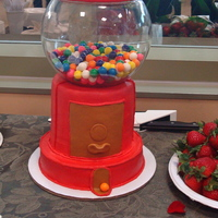 Gumball Machine   Made for a birthday party. All buttercream frosted. I also used real gumballs and some fondant accents.