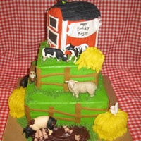 Farm Fun Cake is decorated in buttercream with Fondant accents. Animals are plastic.