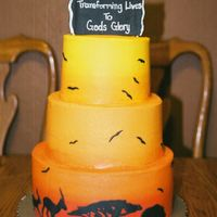 African Sunset Send off cake for a family about to head off to the mission field in Africa. All buttercream with gumpaste accents.