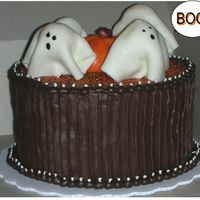 Ghosts Love Chocolate! Total copy of VickiC's cake...but hers is SO much better!! Thanks for posting your cake VickiC!! I'd had a little too much coffee...