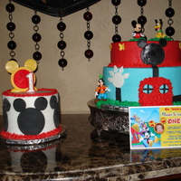 "Mickey Mouse Clubhouse Cake For A First Birthday. 10"", 8"", and 6"" with buttercream icing and fondant."