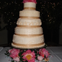 Megan's Wedding Cake Round stacked layers, 16, 14, 12, 10 and a 6. Peonies were used around the cake
