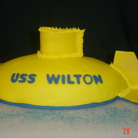 Uss Wilton This submarine cake is covered in fondant and formed with the Wilton football shaped pan. The fins are made from dried fondant.