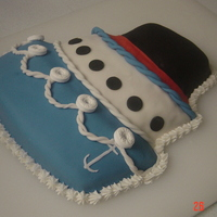 Bon Voyage Wilton's Topsy Turvy cake pan makes a great cruise ship! Covered in Fondant. This one was a lot of fun.