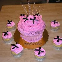 Sweet 16 Giant Cupcake   Sweet 16 giant cupcake and 2 dz regular cucakes. Pink and black. Thanks for looking!!
