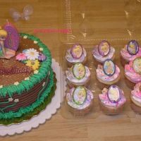 Tinkerbell For Monica Tinkerbell cake and cupcakes for Monica. Plastic cupcake rings and sugar accents on the cake. Thanks for looking!!