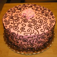 Pink And Brown Swirls Pink and Brown swirl cake with dragees.