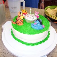 Pooh And Friends   This is the cake I made for my son's first birthday. Grass is bc, figures were sculpted with mmf.