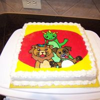 Baby Einstein Cake I did this cake for my niece's 4th birthday. I scanned the picture off of a pinata (a challenge in itself). FBCT.