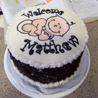 Baby Shower Cake Cookies and cream cake with cream cheese frosting. Sides are covered with crumbled Oreos. Top is FBCT.