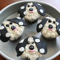 Doggie Cupcakes   Frosted in marshmallow buttercream with fondant accents.