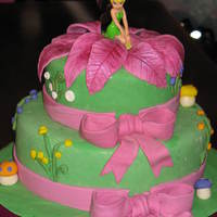 Tinkerbell Made for little girl's 4th birthday. All decorations are fondant/gumpaste except for Tinkerbell. I knew I wouldn't be able to...
