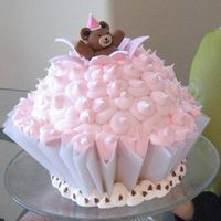 "Teddy Bear Cupcake Cake Teddy bear topper modeled after Wilton's 2009 cover. Cupcake ""liner"" made out of parchment."
