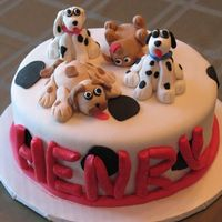 Dogs Cake covered in fondant. Dogs made of fondant for 4th birthday (one dog for each year).