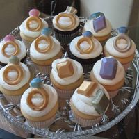 "Bling Cupcakes Made for a ""jewelry party."" Rings and gems made out of white chocolate decorated in luster dust."