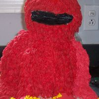 3D Elmo Thanks to many others photos here that helped me with this. Buttercream, Strawberry cake, Fondant for Eyes & Nose