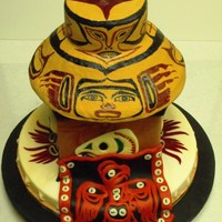 "Haida-Tlingit Inspired Competition Cake My entry into the Cove Country Cake Competition.Dummy construction w/ modeled RKTs for the brim if the hat.Bottom 2"" tier is a tribal..."