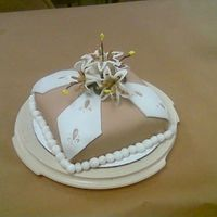 Gumpaste Class Final Cake this is my final cake for the fondont and gumpaste class. It is a french vanilla cake with chocolate mmg. the flowers are lilies. My...
