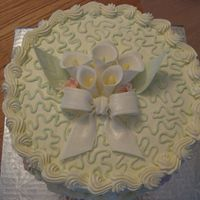 Ccresize1.jpg Chocolate coconut cake covered in whipped topping (nutrawhip). I made my first gumpaste bow for this one:)