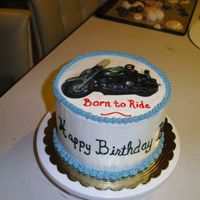 Motorcycle Birthday This was a cake I did for a co-worker's boyfriend. I had a transparency copied and cut it out and put it on a cake. They enjoyed it.