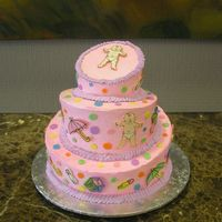 Whimsical Baby Shower Cake   This cake was done whimsical style with candy melt pictures on the sides and top.