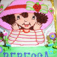 Strawberry Shortcake This was for a co-workers 4 yo birthday. The botttom cake is strawberry flavored. The green is pound cake and the character pan is...