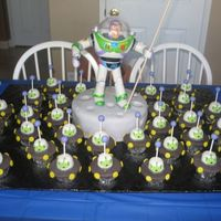 Buzz Lightyear And The Little Green Men Had some trouble with coming up with a buzz cake so here is what I did:Buzz is a toy on top of a 10 inch round cake covered in fondant....