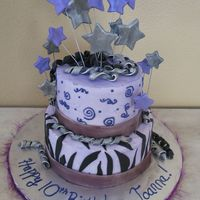 "Purple ""diva"" Birthday Cake 8 inch and 6 inch round buttercream cake with fondant accents. Edible luster dust added."