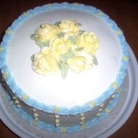 Lemon Cake With Lemon Buttercream First try at smoothing buttercream the Viva papertowel way! Need lots more pratice.