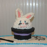 Pulling A Rabbit Out Of A Hat  This was made for my son's 7th bday - Magic Theme. Shortly after this photo was taken I had to perform emergency ear replacement...