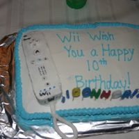 Wii Wish You A Happy Birthday!  Wii console cut from an 8x8 cake pan and placed ontop of a 9x13 cake. Used fondant for buttons, etc. This was a 'practice' or &#...