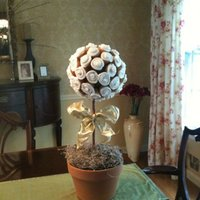 Cupcake Topiary   About 60 mini cupcakes attached to a styrofoam ball with toothpicks; easy baking, tricky engineering! (first try keeled over!)