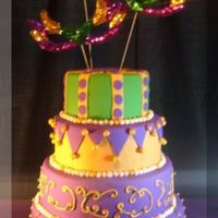 Mardi Gras Birthday Cake The mom picked out this cake for her daughter's 16th B-day. She brought a picture that was similar but in different colors. The bad...